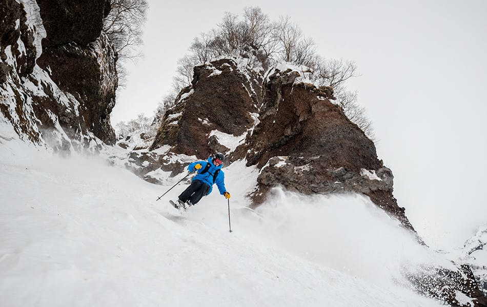 Skiing the rocky outcrops of Rishiri