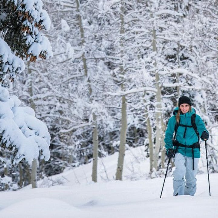 Photograph by Andy Earl of a woman using snow trekkers