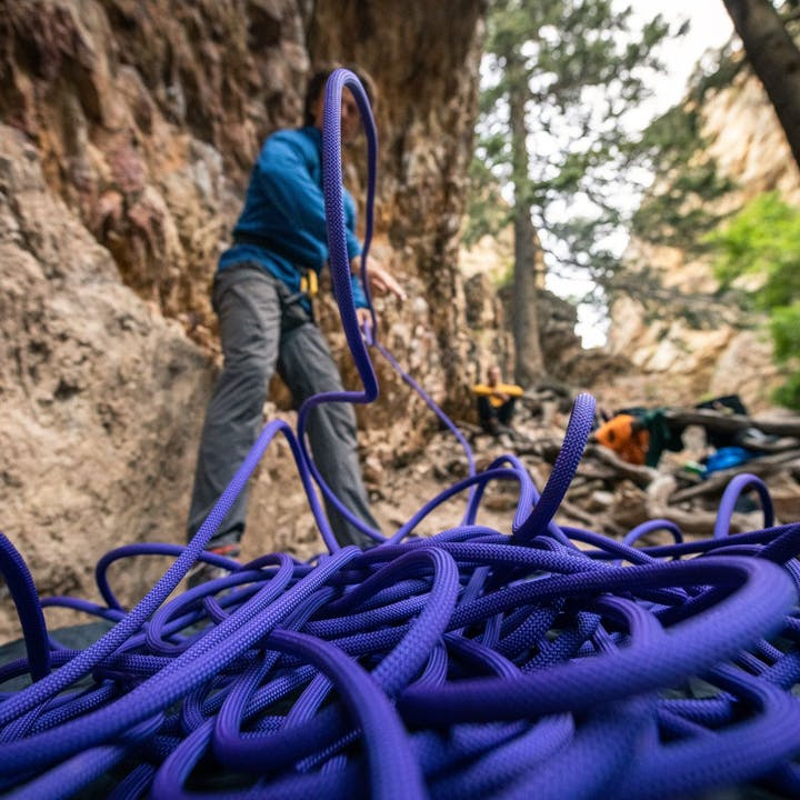 Photograph by Andy Earl of man flaking rope outdoors