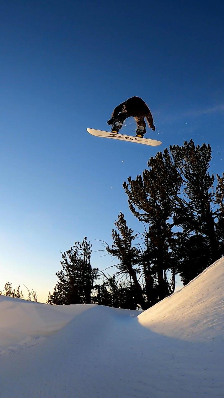 John Jackson hitting a jump on his snowboard