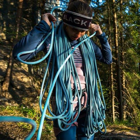 Black Diamond athlete Babsi Zangerl coiling climbing rope outside