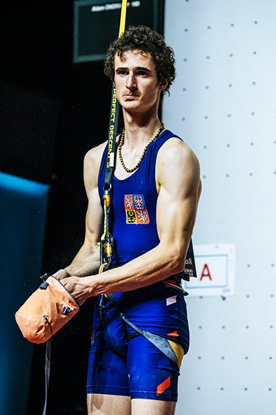 Adam Ondra preparing to compete on the speed wall