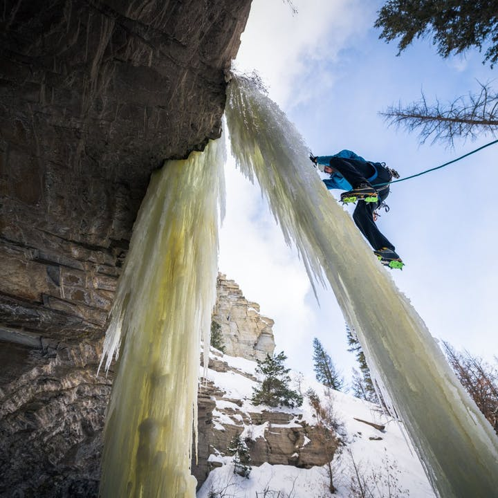 A photo by Andy Earl of Jackson Marvell ice climbing