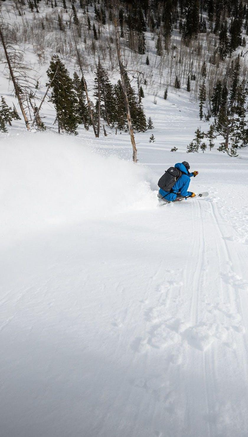 skier going through a powder field