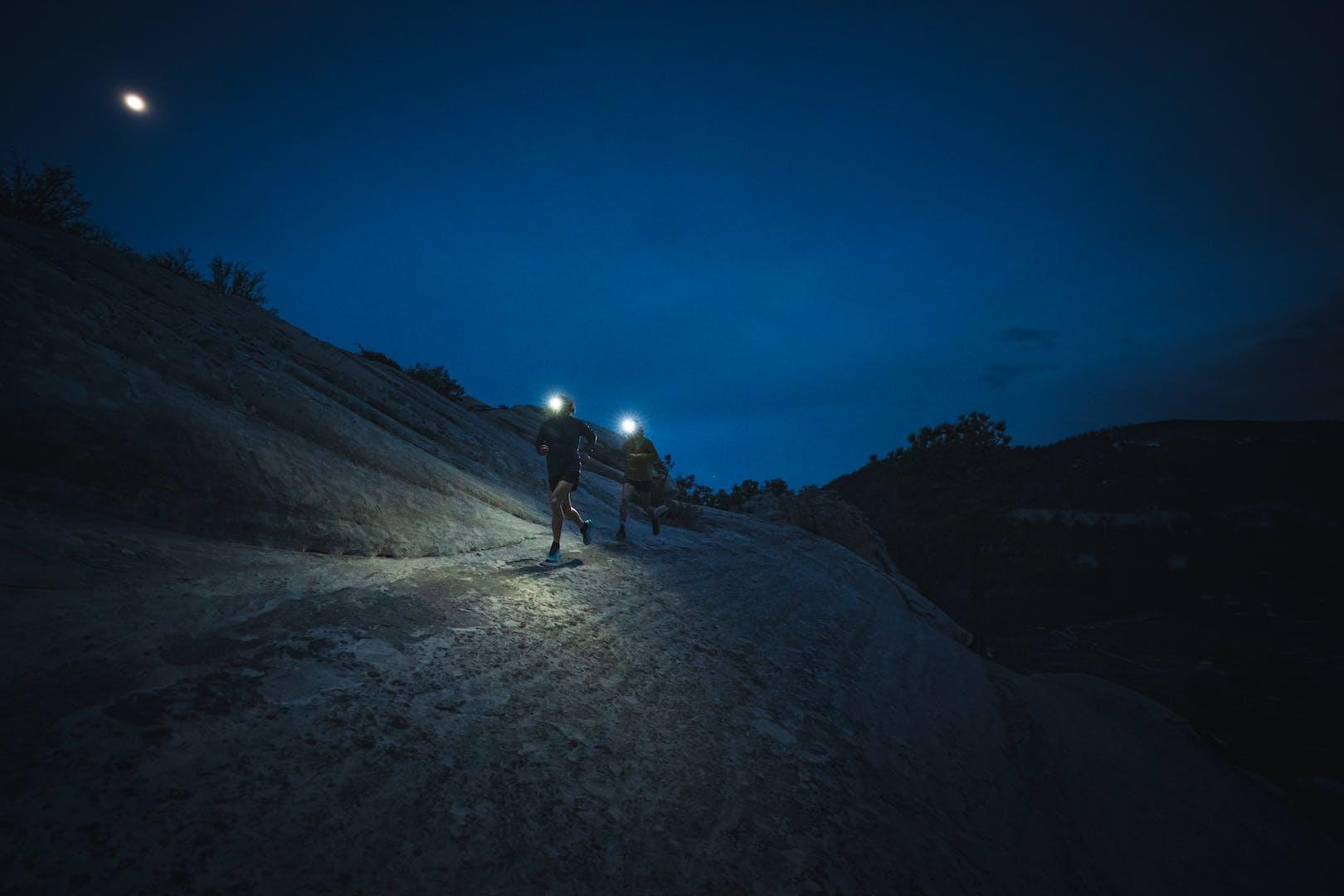 BD athletes Kyle Richardson and Joe Grant running at night