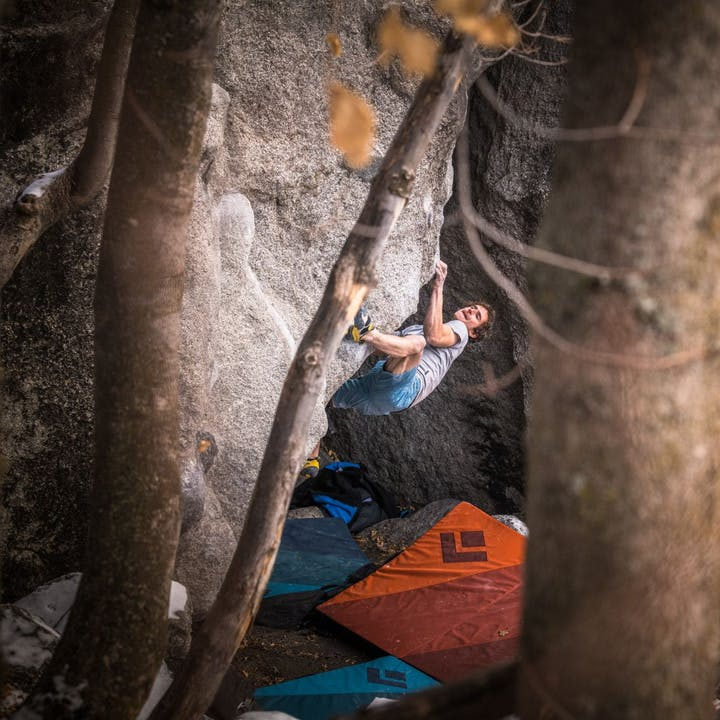 Photograph by Andy Earl of Adam Ondra bouldering