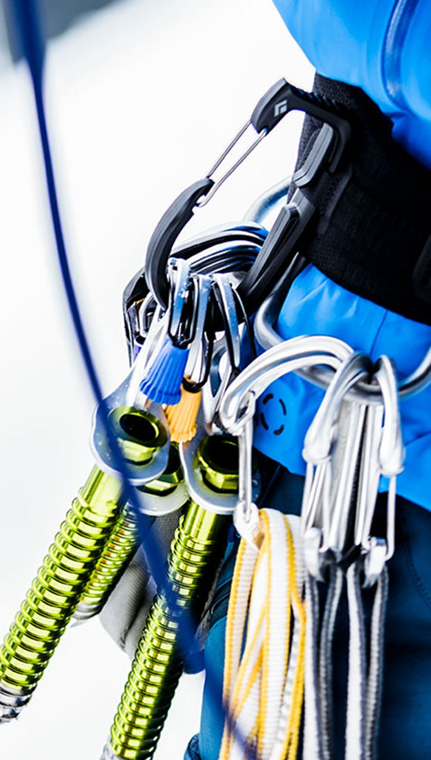 ice climbing gear hanging from harness