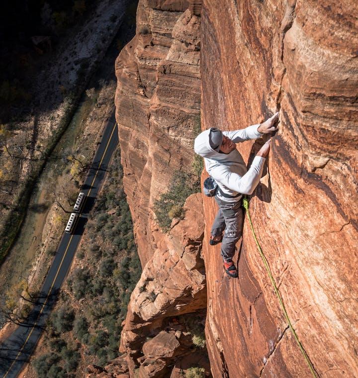 MAN CLIMBING A ROUTE