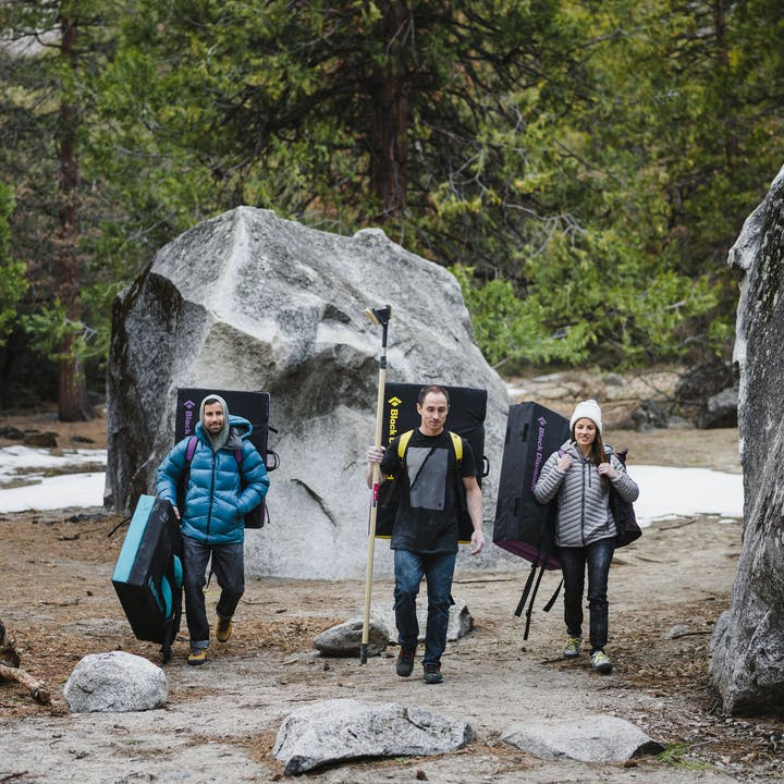 Climbers walking among boulders | New Climbing gear