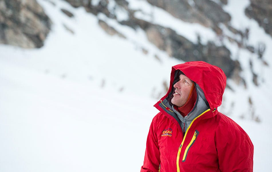 Exum Guide looking at snow conditions