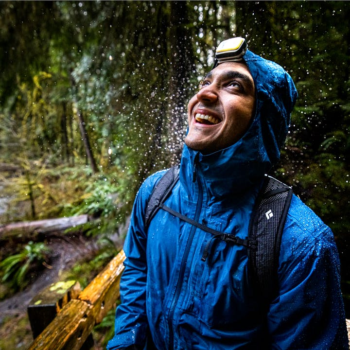 A hiker wearing a Black Diamond Rain Jacket in Olympic National Forest.