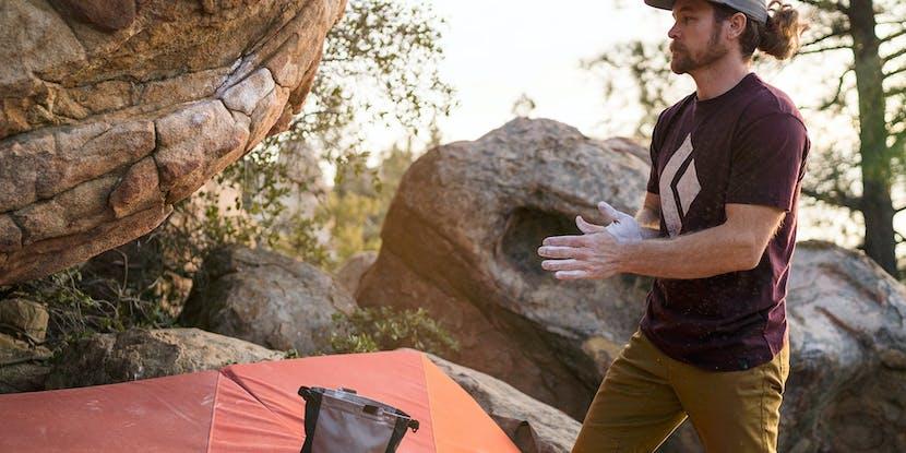 climber assessing a boulder