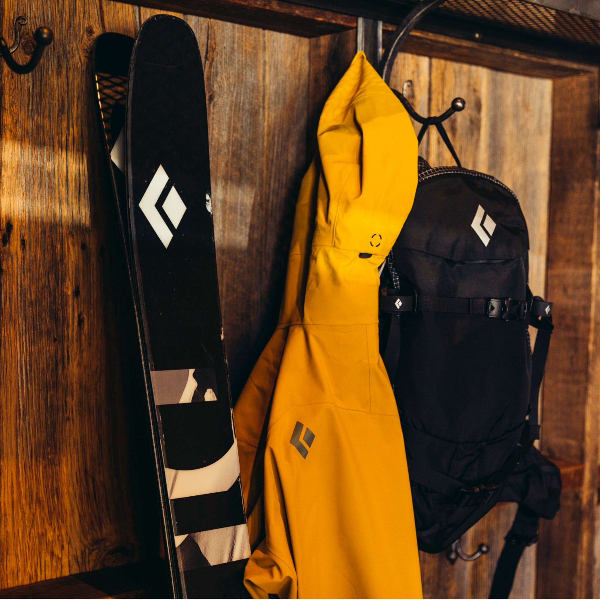 A Black Diamond outerwear kit hanging in a house.