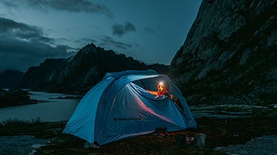 Tent illuminated by a headlamp