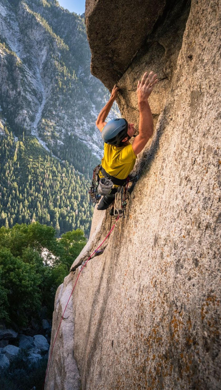 Trad climber makes his next move while wearing the Vision Helmet.