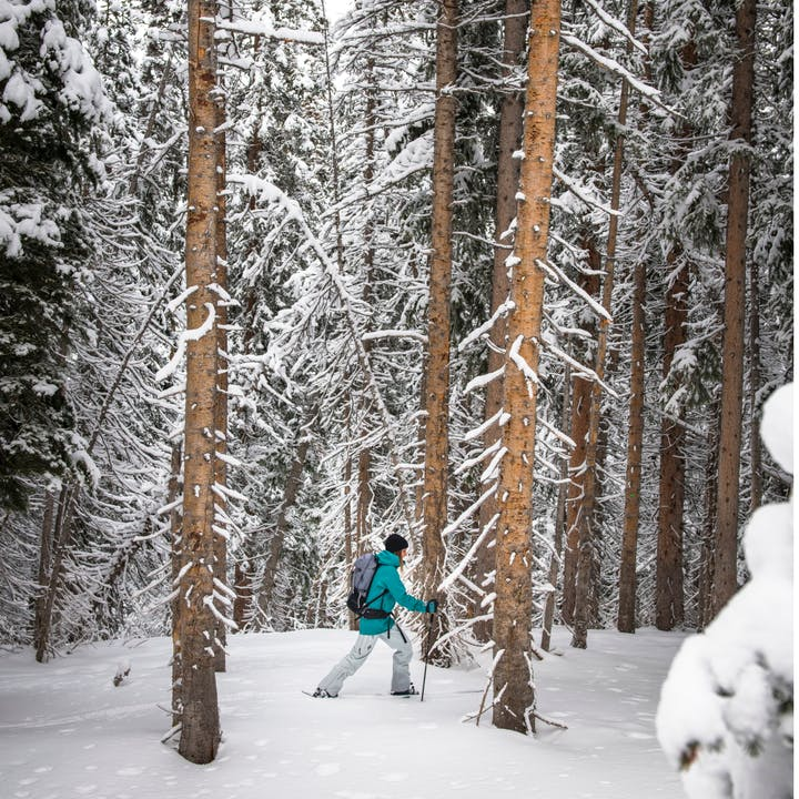 Photograph by Andy Earl of a woman using snow trekkers.