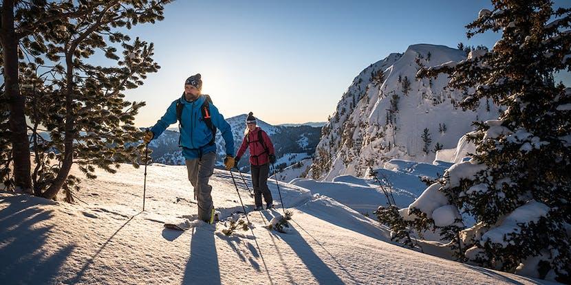 skiers touring along a ridgeline