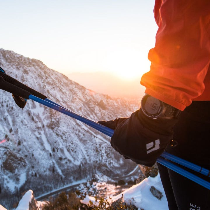 Photograph by Andy Earl of a person holding ski poles in the mountains