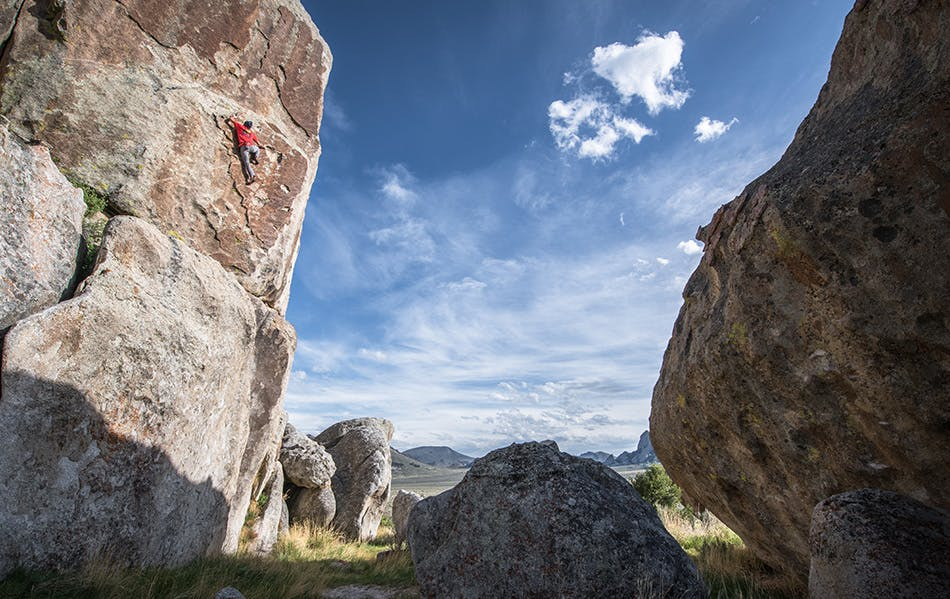 athlete climbing up a route