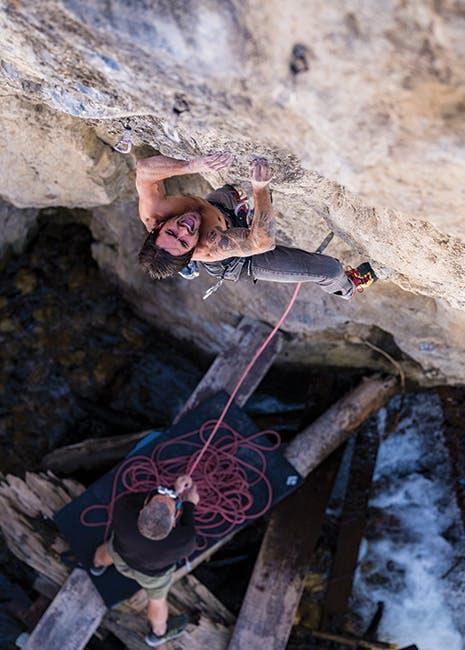Sam Elias climbing