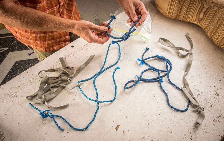 engineer reviewing the tested webbing and cord