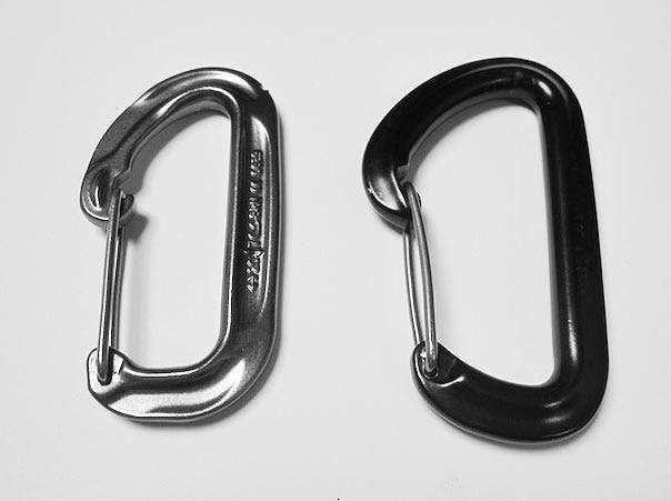 side-by-side comparison of two carabiners