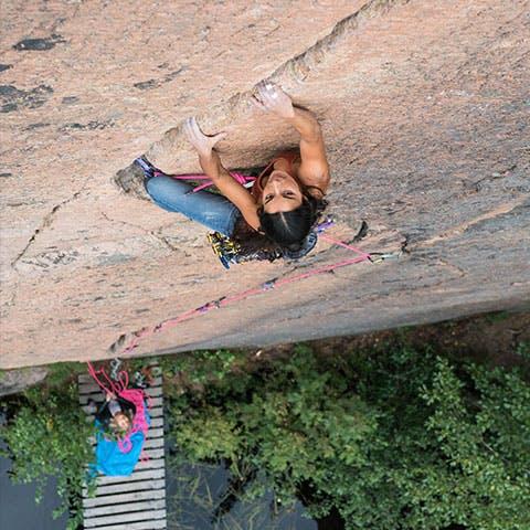 woman climbing a crack