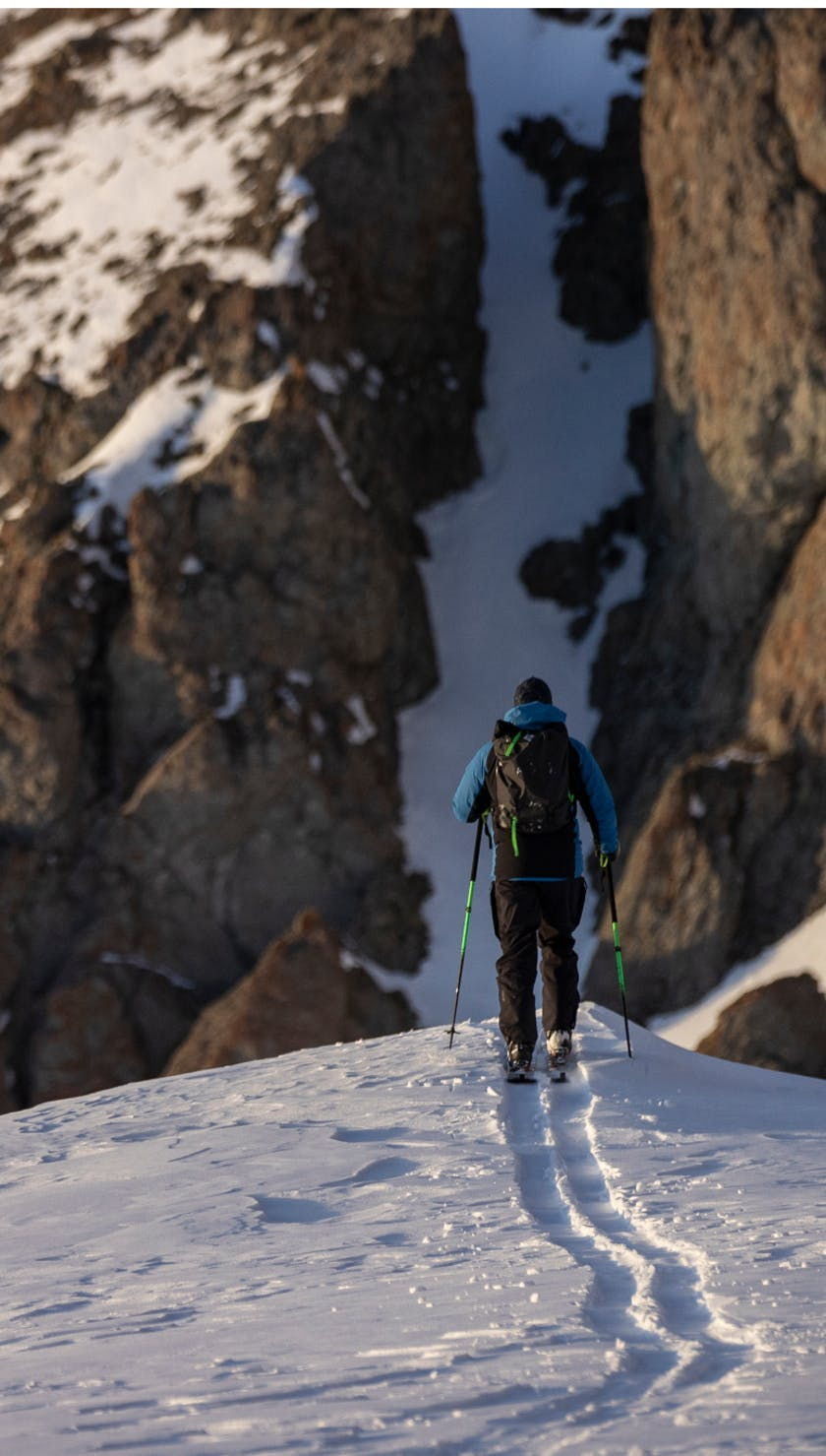 A skier touring with the Black Diamond Cirque Hybrid Glove in Silverton, Colorado.
