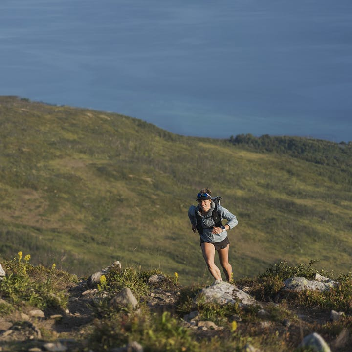 Hillary Gerardi running up a mountain near the seas