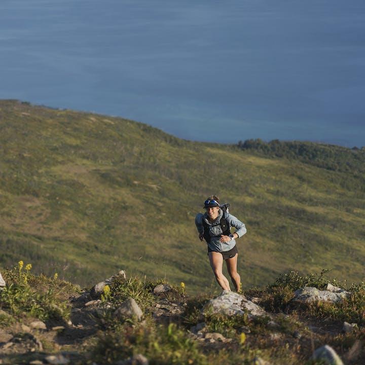 Hillary Gerardi running up a mountain near the seas | Women's Shorts