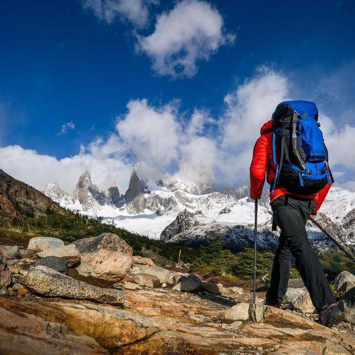 Photograph by Ted Hesser of man trekking in mountains