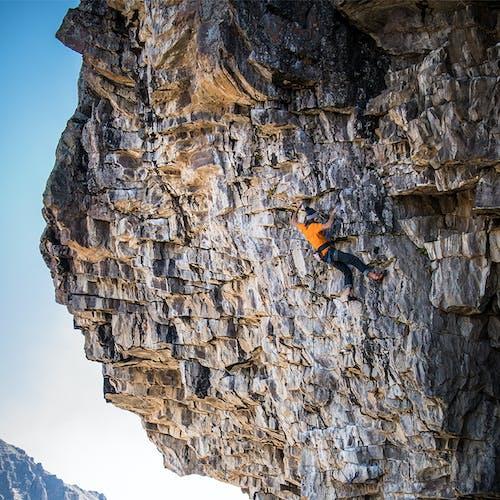 Jackson Marvell climbing rock
