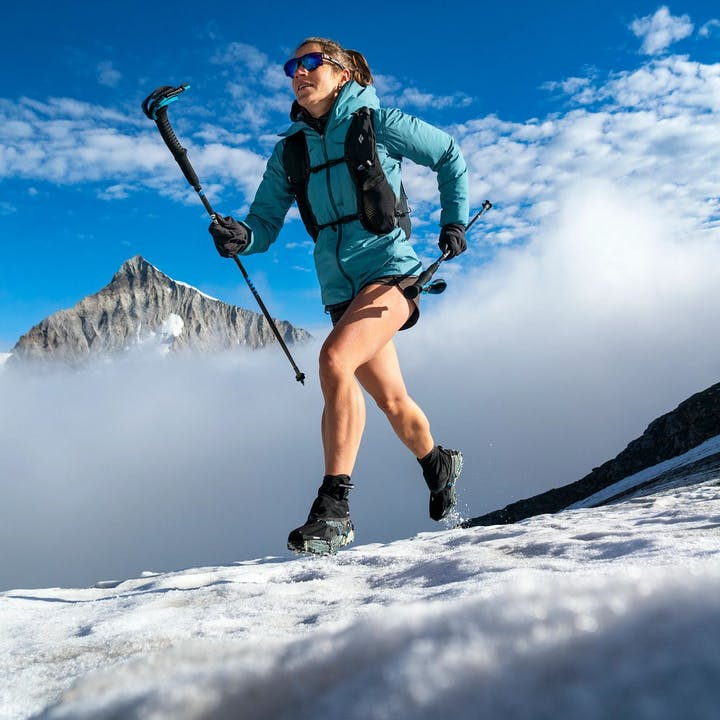 Photograph by Dan Patitucci of Hillary Gerardi running in the mountains