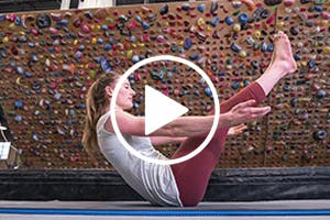 Thumbnail image for a video of Claire Buhrfeind in a rock gym with play button overlaid.