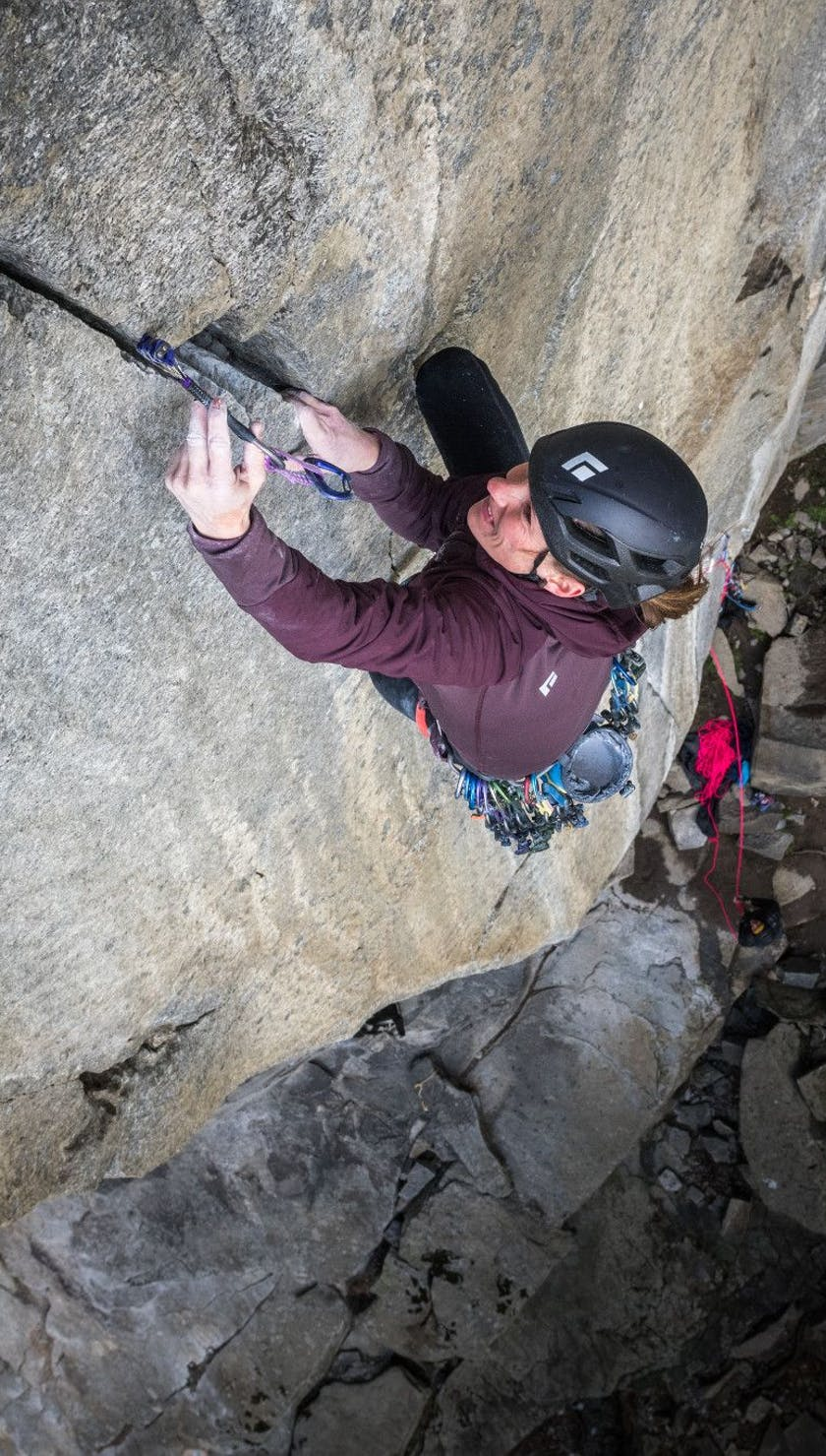 Climber places a Z4 camalot while on lead.