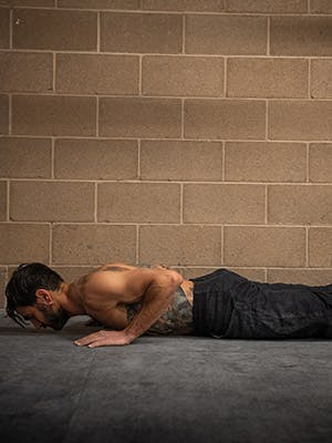 Profile photo of Sam Elias in lower pushup motion.