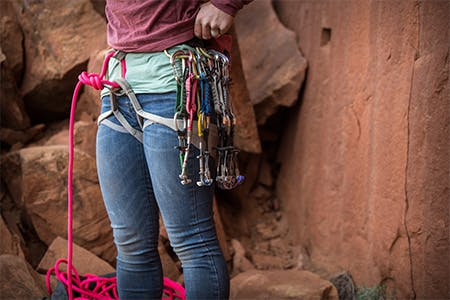 Photograph by Andy Earl of Hazel Findlay's harness with climbing gear hanging off it.