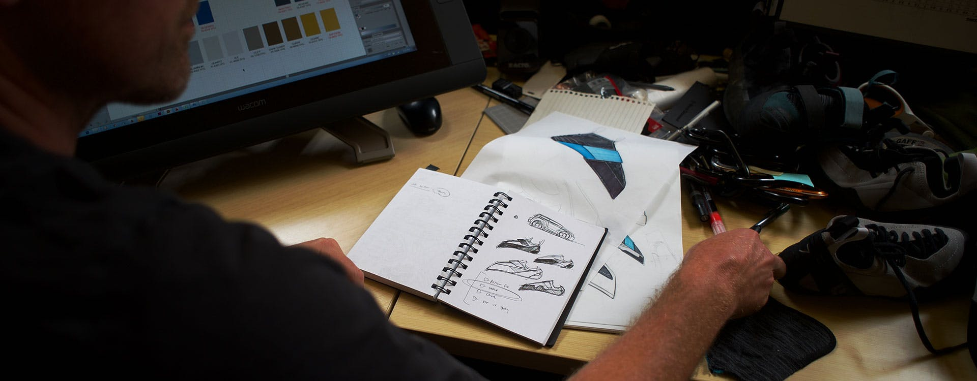 designer working with sketches and prototypes of BD climbing shoes