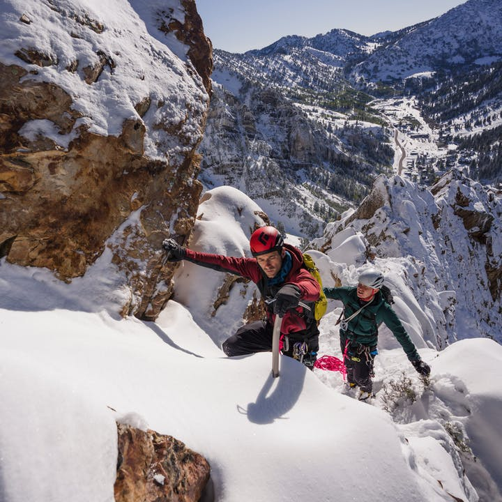 A photo by Christian Adam of two men mountaineering | Mountaineering Gear