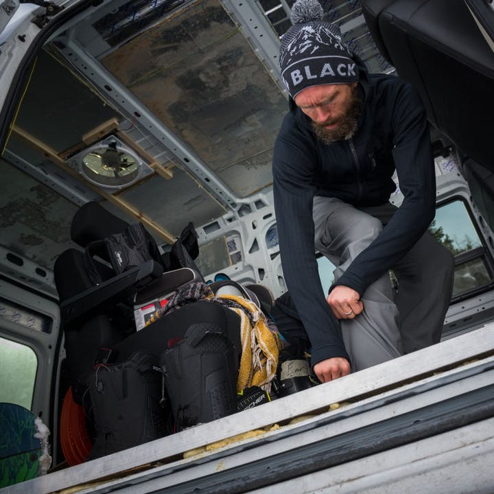 Photograph by Andy Earl of a man preparing gear in the back of a van