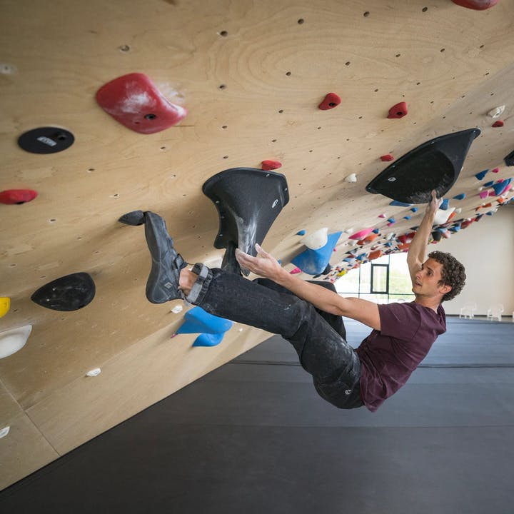 Photograph by Christian Adam of a man bouldering in a climbing gym
