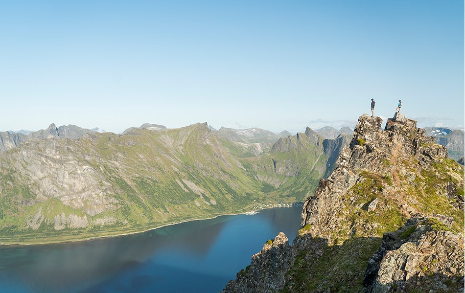 Hillary Gerardi and Kyle Richardson stand on a mountain in Norway