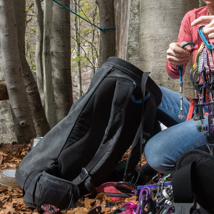 Photograph by Andy Earl of BD Athlete Babsi Zangerl organizing climbing gear outside
