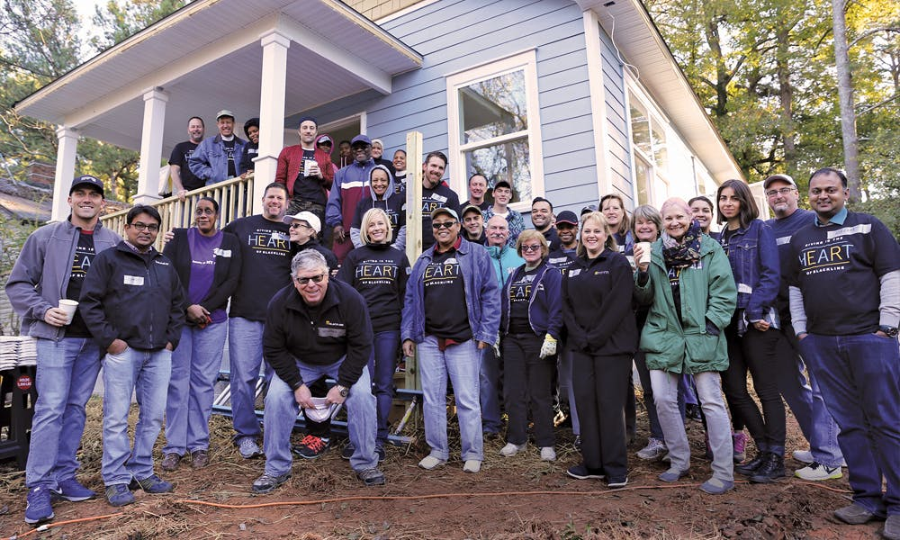 Giving Back volunteers show their nearly-completed project
