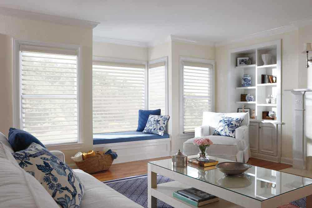 Window treatments for bay window with seat