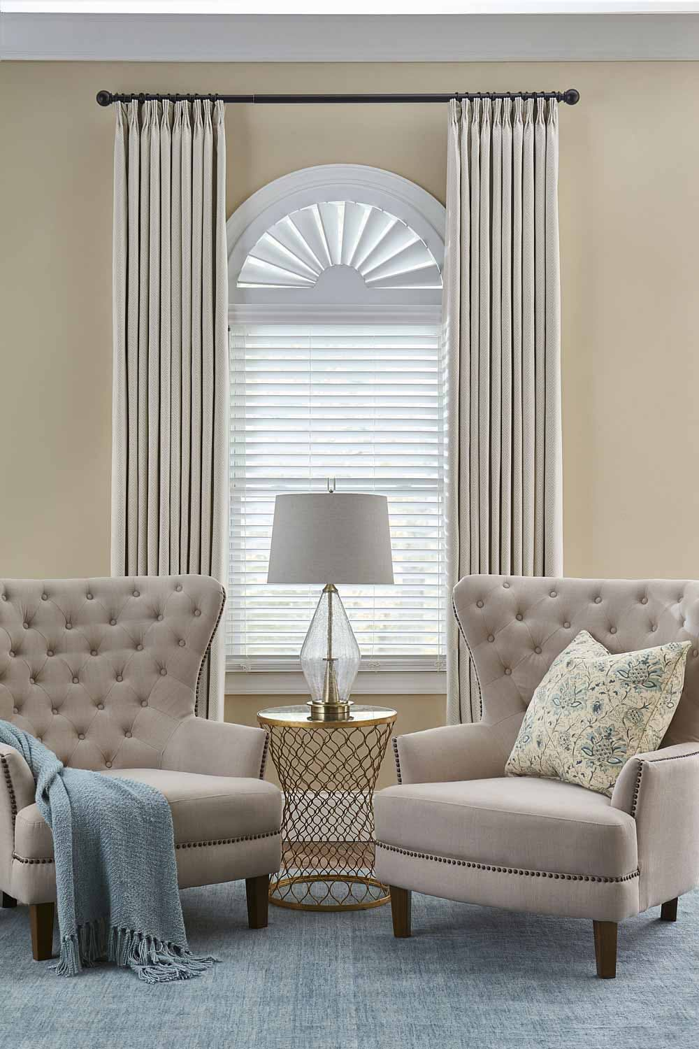 arched window with blinds and curtains
