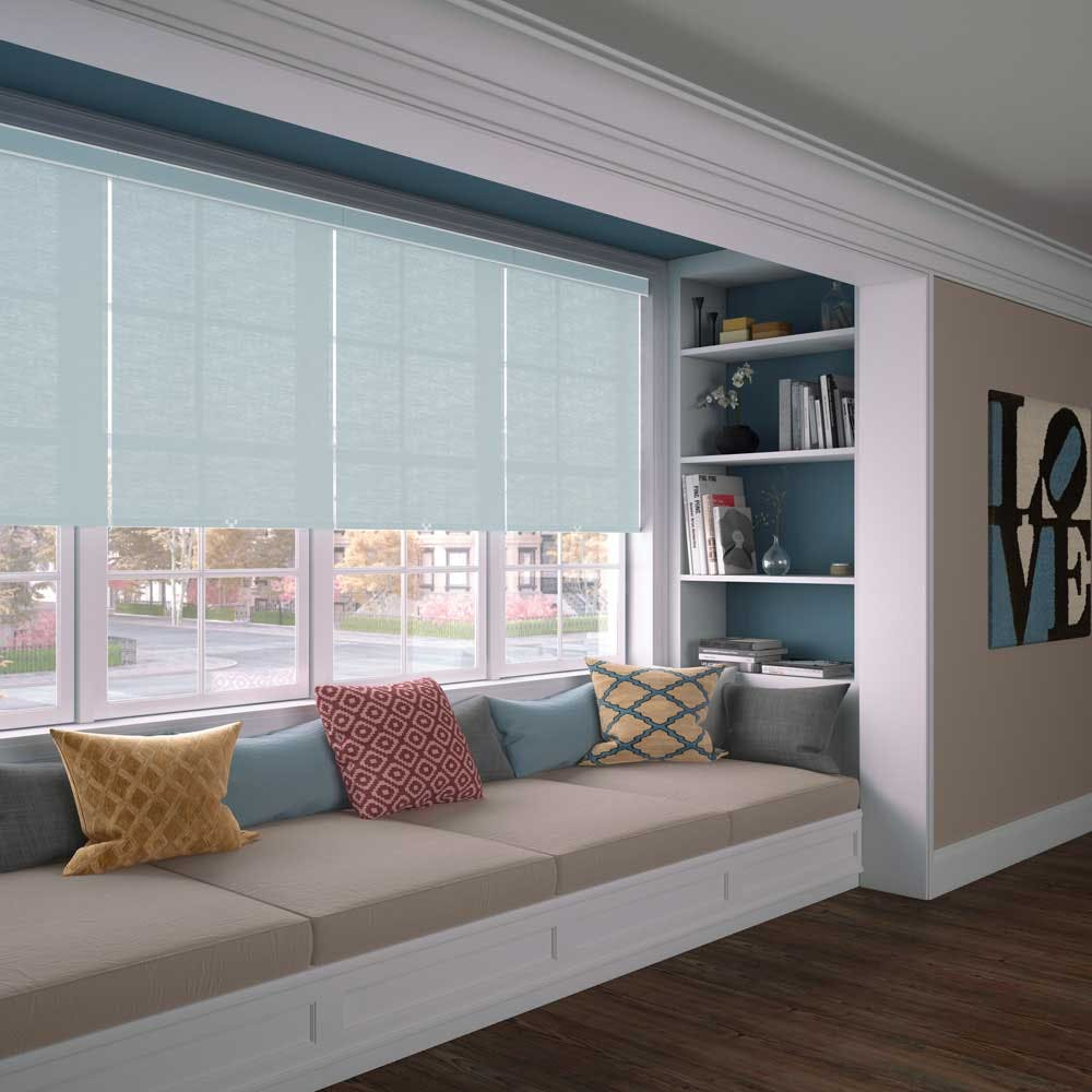 Window seat with bookshelves on sides and blue roller shades