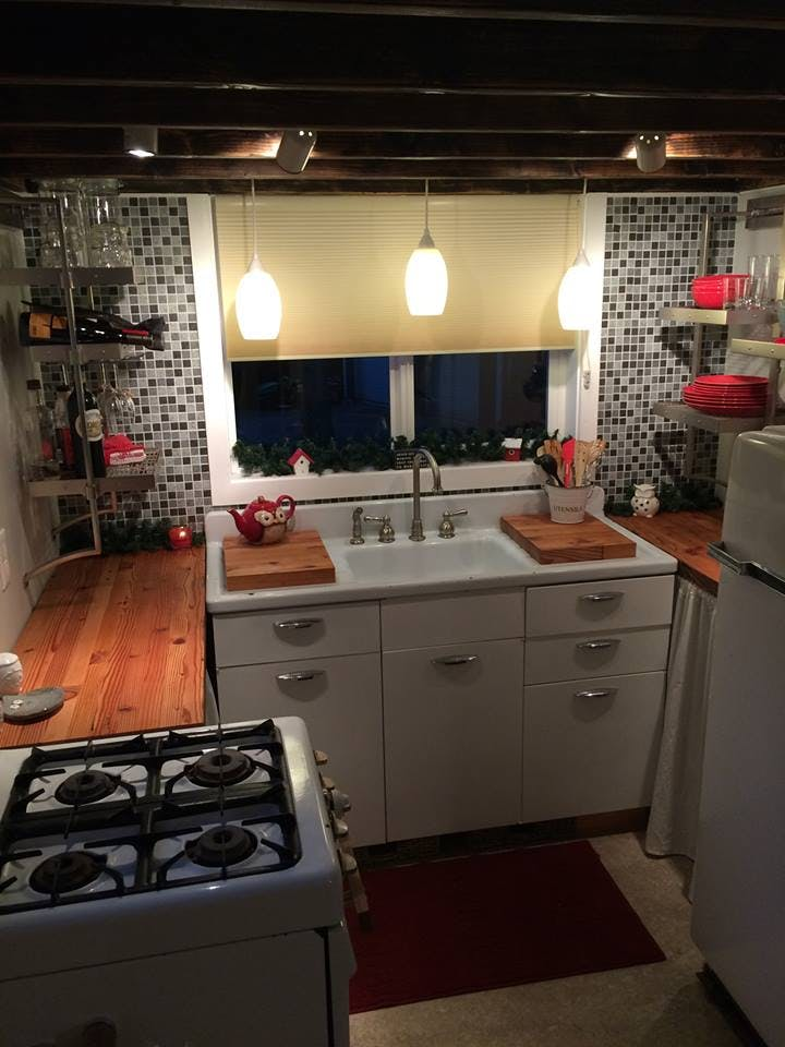 tiny home with kitchen with beige cellular shades