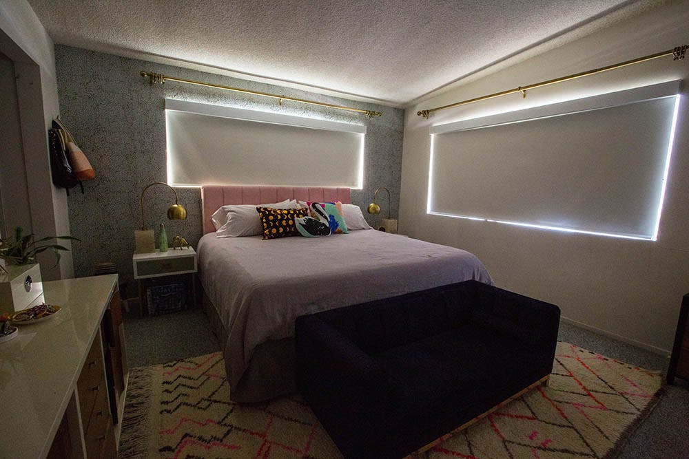 modern bedroom with blackout shades and very visible light gaps on the sides.
