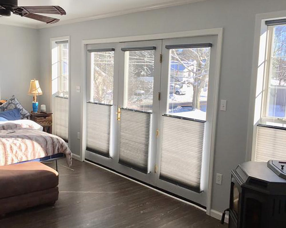 Bedroom french doors with cellular shades.